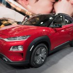Hyundai Kona Electric red front three quarters at 2018 Geneva Motor Show