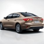 2018 Ford Focus Sedan rear three quarters studio image