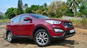 2013 Hyundai Santa Fe Review front quarter red