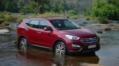 2013 Hyundai Santa Fe Review red front quarter