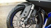 2014 Yamaha YZF-R125 front wheel detail press shot