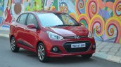 Hyundai Xcent Review red front quarter