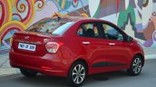 Hyundai Xcent Review red rear quarter