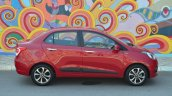 Hyundai Xcent Review red side view