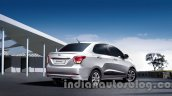 Hyundai Xcent rear three quarters official image