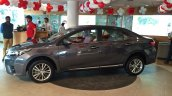 2014 Toyota Corolla spied Indian dealership side