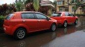 Tata Fiat Punto Evo vs Fiat Grande Punto rear three quarter