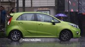 Proton Iriz driven by Dr. Mahathir Mohamad side