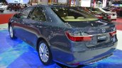 Toyota Camry Hybrid rear three quarter left at the 2015 Bangkok Motor Show