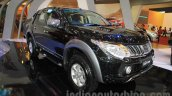 Mitsubishi Triton Exceed black front three quarters at the Gaikindo Indonesia International Auto Show 2015 (GIIAS 2015)