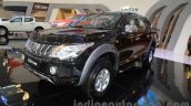 Mitsubishi Triton Exceed black front three quarters right at the Gaikindo Indonesia International Auto Show 2015 (GIIAS 2015)