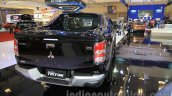 Mitsubishi Triton Exceed black rear three quarters right at the Gaikindo Indonesia International Auto Show 2015 (GIIAS 2015)