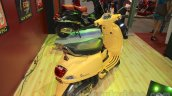 Vespa VX rear three quarter yellow at Nepal Auto Show 2015