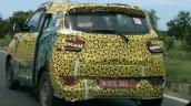 Mahindra S101 camouflaged prototype rear quarter spied
