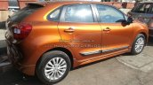 Maruti Baleno with optional bodykit and Ciaz alloys side Spied