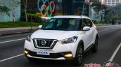 Nissan Kicks official image front three quarters urban driving shot