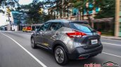 Nissan Kicks official image rear three quarters urban driving shot
