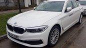 2017 BMW 5 Series 530e iPerformance white front three quarters Munich