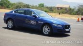 Jaguar XE front three quarters right side at Jaguar The Art of Performance Tour