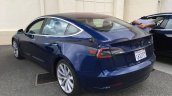 Tesla Model 3 blue rear three quarters spy shot