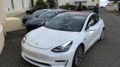 Tesla Model 3 white front three quarters left side spy shots
