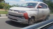 2017 Mahindra KUV100 (facelift) front three quarters left side spy shot