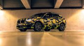 Camouflaged BMW X2 low quarter snapped Milano Fashion Show