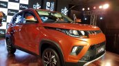 Mahindra KUV100 NXT Fiery Orange front three quarters right side