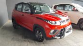 Mahindra KUV100 NXT Red & Black accessorised front three quarters