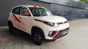 Mahindra KUV100 NXT white accessorised front three quarters right side