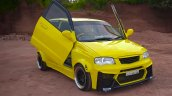 Modified Maruti Alto yellow scissor doors