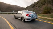 2018 Honda Civic diesel rear three quarters left side dynamic highway shot