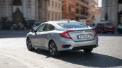 2018 Honda Civic diesel rear three quarters urban scenic image