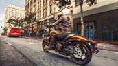 Kawasaki Vulcan S Pearl Lava Orange press rear angle action
