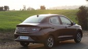 Hyundai Aura Review Images Rear Three Quarters 3
