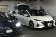 Toyota Prius PHV (Toyota Prius Prime) spotted next to a Tesla Model S