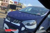 Mahindra U321 (Toyota Innova rival) spotted with the lightest camo yet