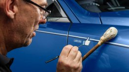 Rolls Royce celebrates reaching a million Facebook fans by painting a 'like' on one