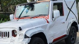 Red 2020 Mahindra Thar with all the production elements spied