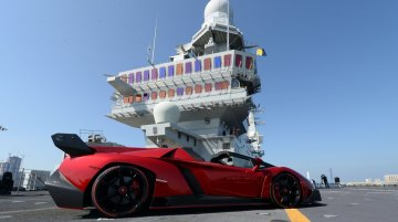 Lamborghini world premieres Veneno Roadster on an aircraft carrier