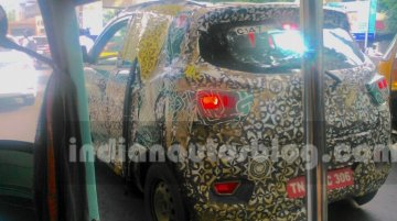 Mahindra S101 (XUV100) spotted with new chrome details - Spied