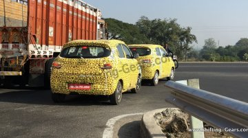 Two Mahindra S101 test mules snapped with yellow camouflage - Spied