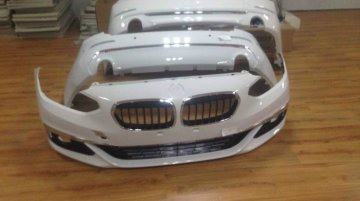 BMW 1 Series sedan's bumpers spied in the flesh