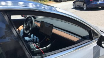 Tesla Model 3's minimalistic interior spied ahead of July unveil