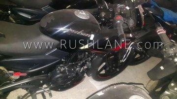 Bajaj Pulsar 220 ABS seen at a dealership; gets rear lift-off protection