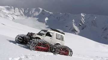 Modified Maruti Gypsy with tank tracks takes on a snow-covered mountain