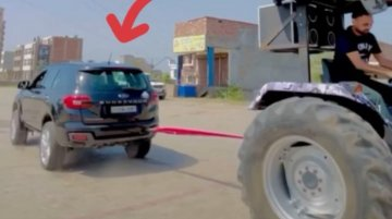 Ford Endeavour Competes with Tractor in Crazy Tug of War Game