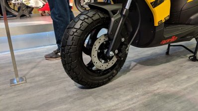 Aprilia Storm Yellow with accessories front wheel at 2018 Auto Expo