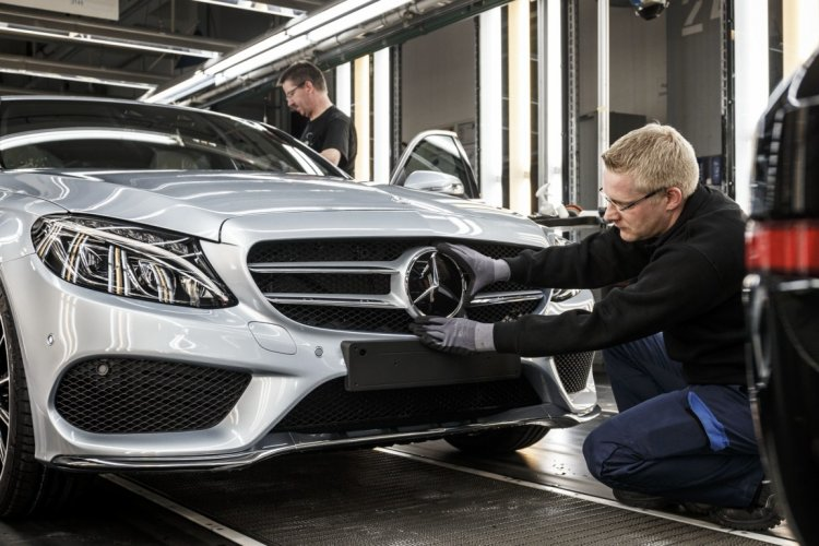 Mercedes-Benz C-Class Bremen plant inauguration logo on grille press shot
