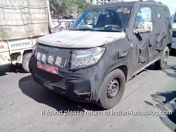 Mahindra U301 front three quarters spied testing in Chennai October 2014